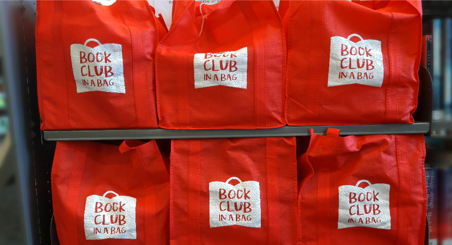 Bags of books on shelf